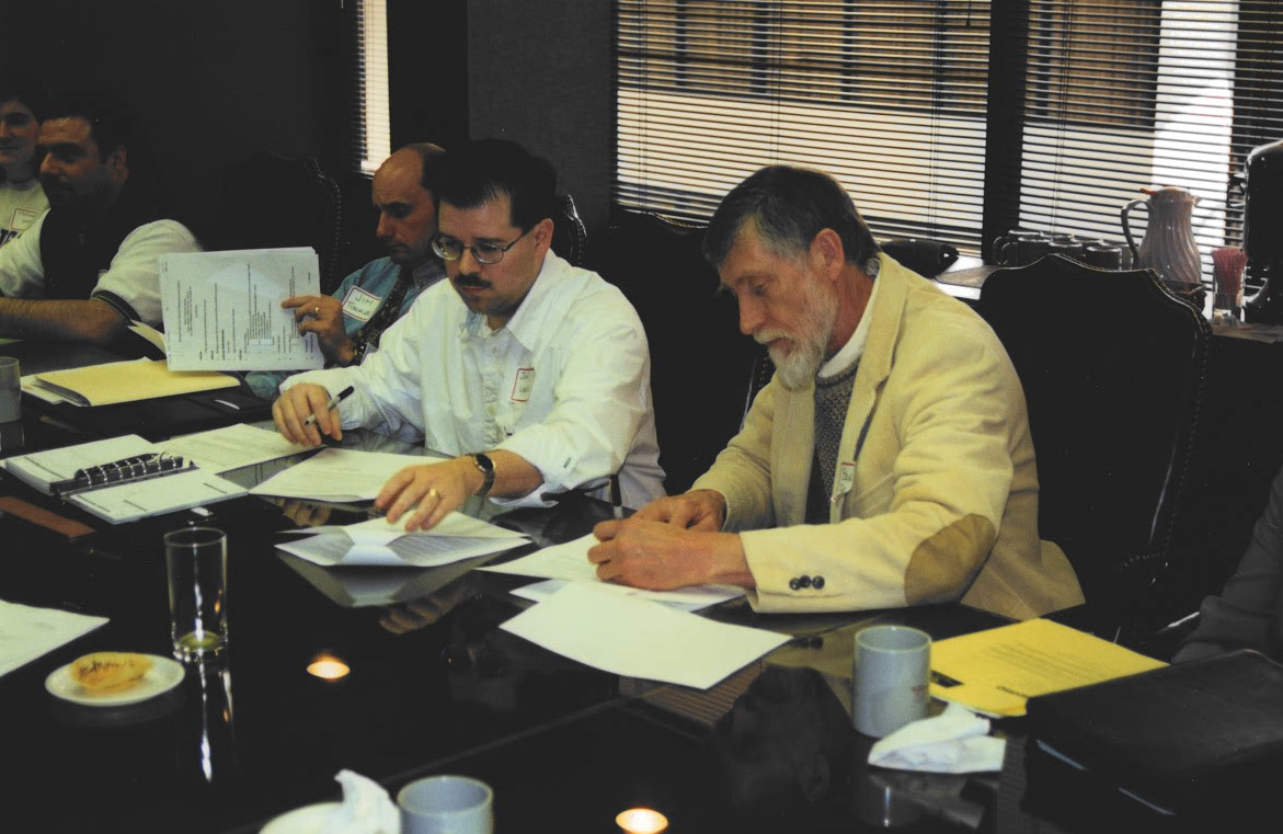 John Sych and Bruce Pape sign merger MSPO/MAPA documents